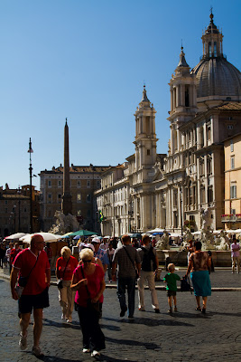 Tourists and the Church if Saint Agnes at Piazza Novona - Rome, Italy
