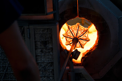 A glass vase being heated in a furnace - Murano, Venice, Italy