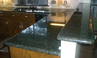 rustic / unpolished granite tiles, or tumbled marble or travertine roman tiles. Natural color or a very clear onyx will fit perfectly