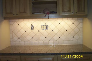 Uba Tuba Backsplash Pics Bottocino tumbled marble with uba tuba dots