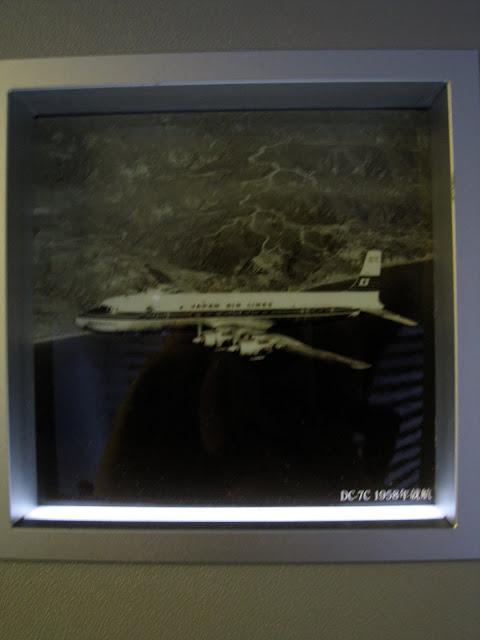Japan Airlines (JAL) Sky Gallery 777-300ER (773) on JL061, DC-7C