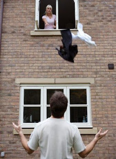 woman throwing a man's clothes out of the window