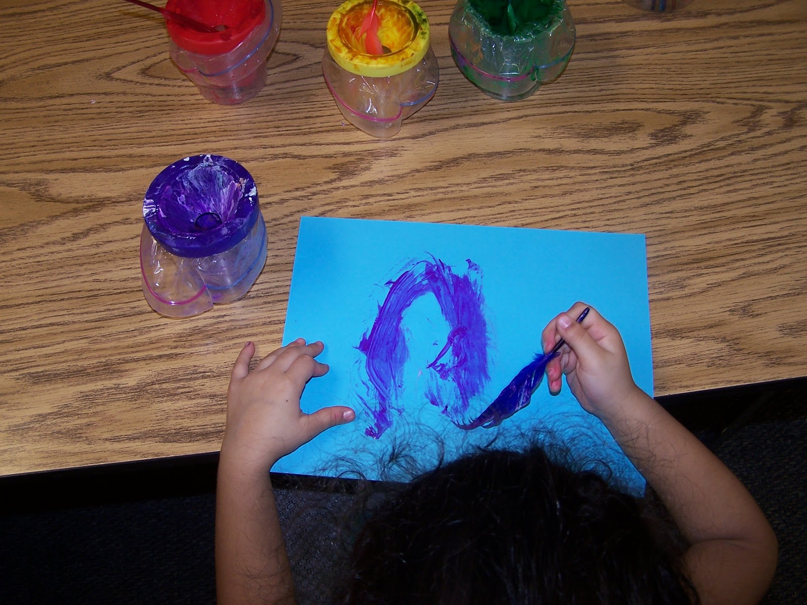 Learning and teaching with preschoolers painting with for Painting feathers on canvas