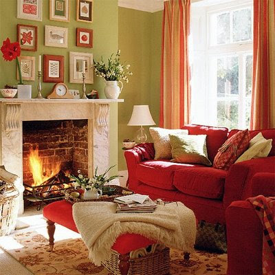 Cosy-living-room-with-red-modern-furnitures-carpet-fireplace-orange-curtains-green-walls-and-decorations