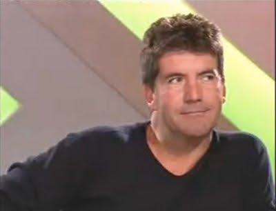 Simon Cowell X Factor Britain American Idol judge smirk smile screencaps images photos pictures screengrabs captures