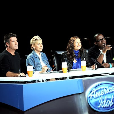Simon Cowell Kara DioGuardi Ellen DeGeneres Randy Jackson American Idol judges panel leaving photos images pictures photos screencaps