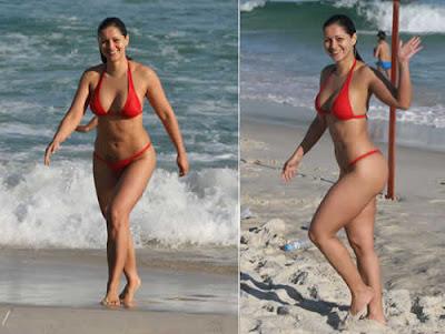 Nana Gouvêa de biquini vermelho curte praia