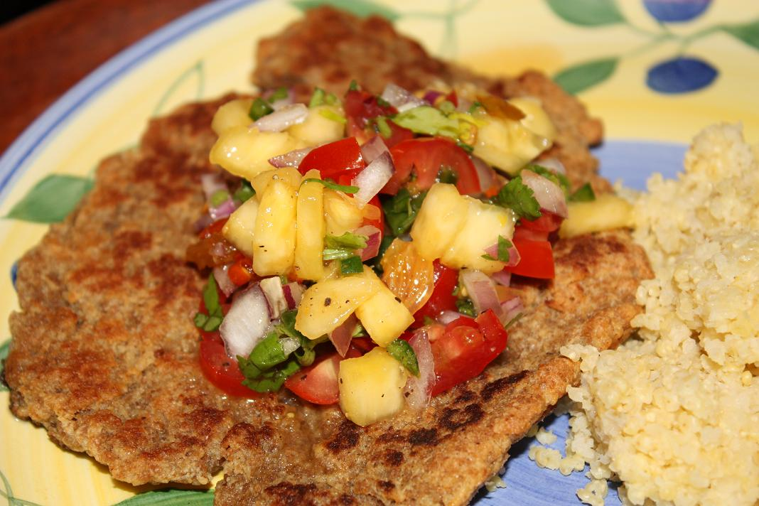 pictured: seitan paillard topped with tropical salsa and millet on ...