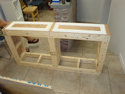 then screw on the plywood top i left about a one inch overhang on the front so i could use it as step to reach above use finishing nails and adhesive to