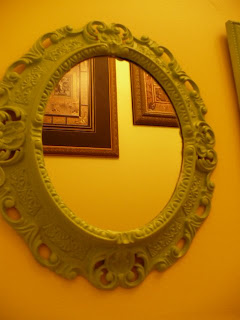 green framed mirror