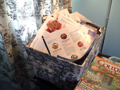 organizing magazines in a bin
