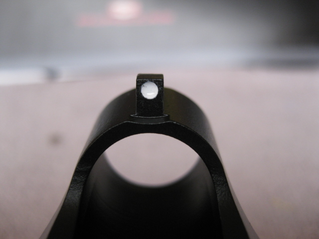 close up white dot front sight installed after Cerakote