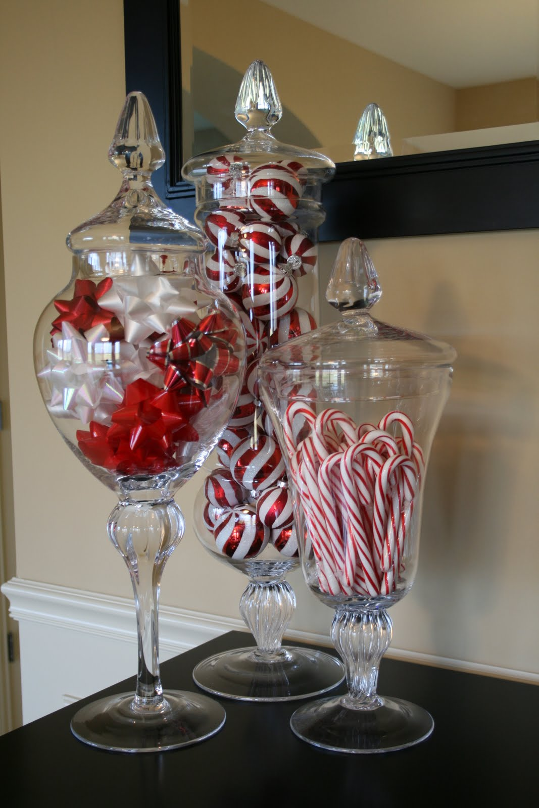 Candycanes, Holiday Bows, and Ornament filled Apothecary Jars