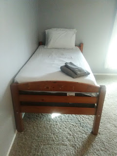 The tidy and cozy twin bed at The Village bed and breakfast.