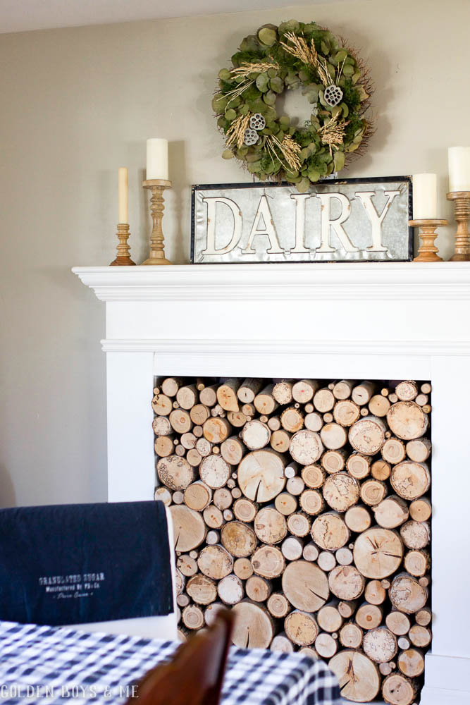 Farmhouse style Dairy sign on mantle in dining room with DIY faux fireplace