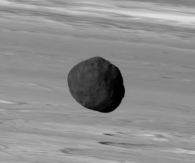 The dark surface of Phobos with Mars as the backdrop, as seen by the European Mars Express ESA.