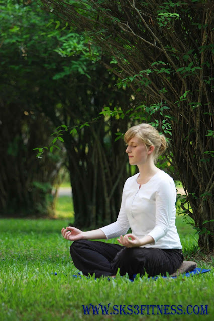 Girl meditating in the garden or park