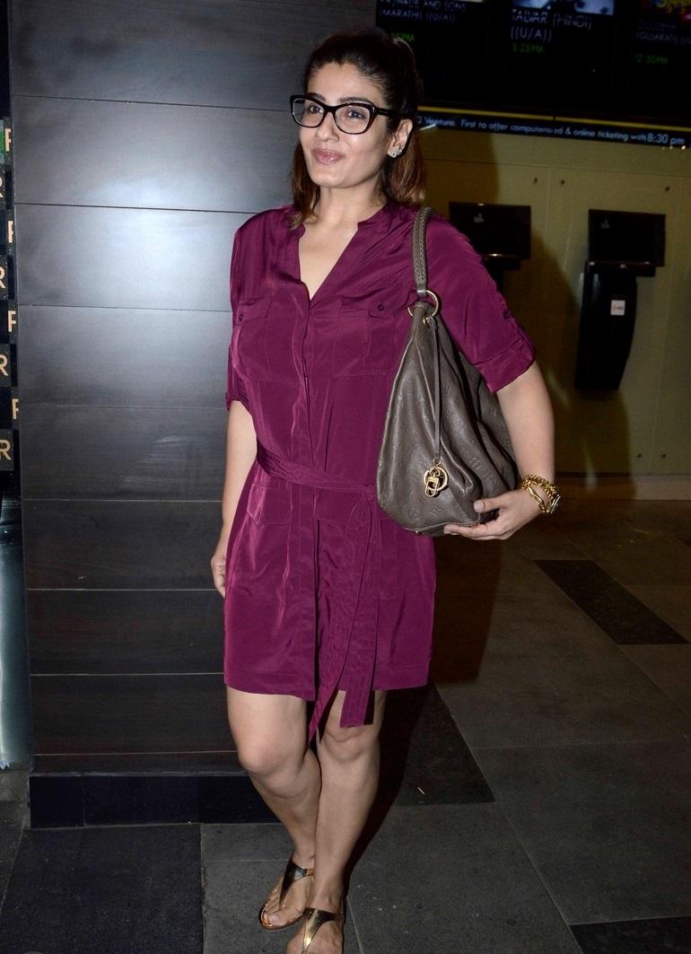 Actress Raveena Tandon Stills In Maroon Dress With Glass
