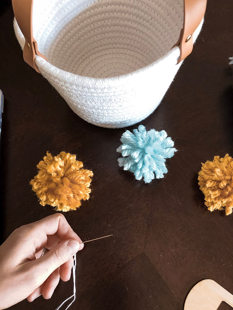 Sew Pom Poms On To Basket
