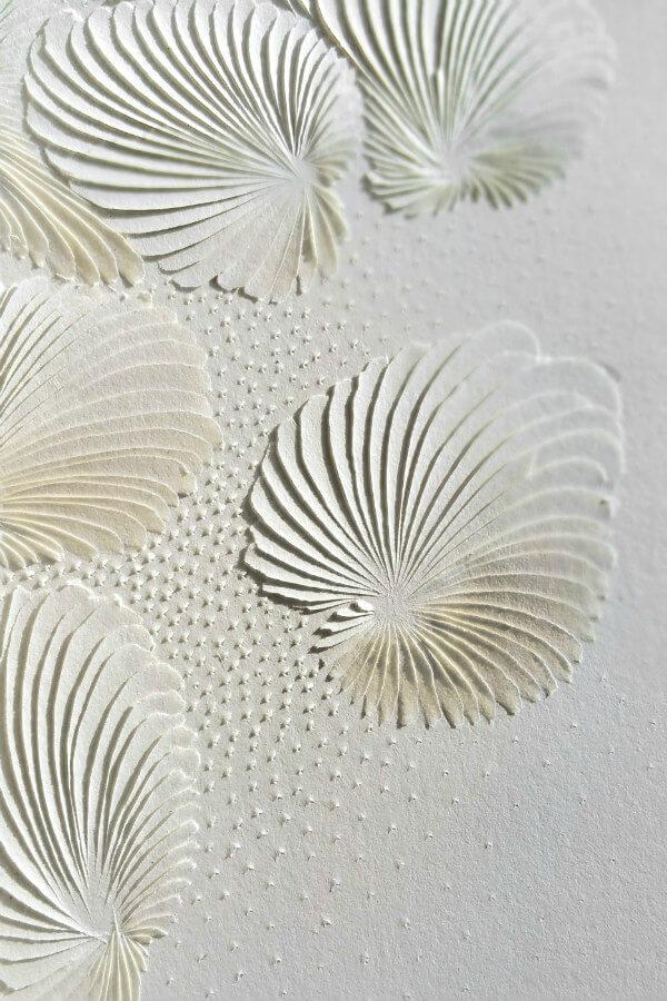 all-white paper carved design