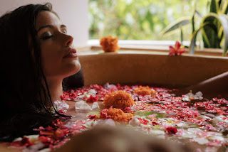 Goddess bath woman bathing in flower petals