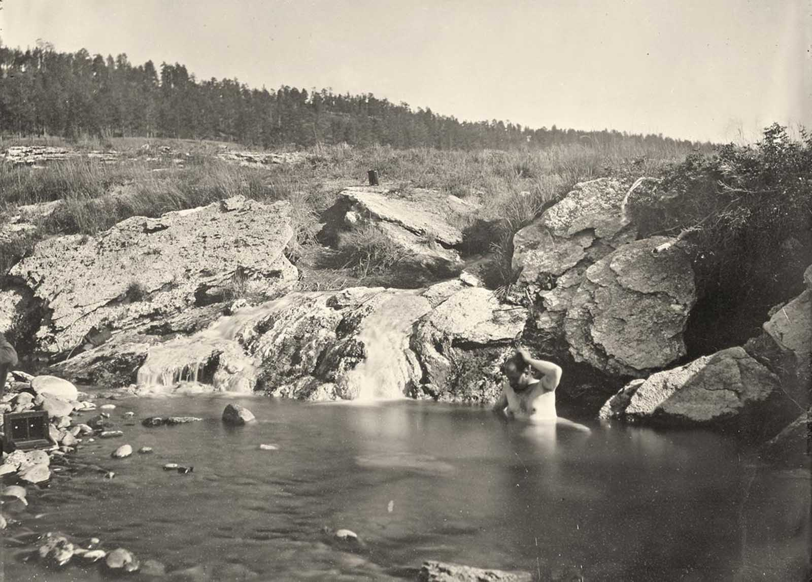 Man bathing in Pagosa Hot Spring, Colorado, in 1874.