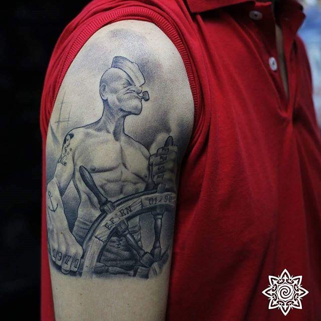popeye arm tattoo