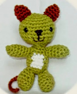 http://www.craftsy.com/pattern/crocheting/toy/little-cat-the-ami---amigurumi-pattern/91286