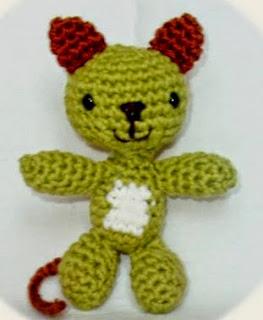 http://www.craftsy.com/pattern/crocheting/toy/little-cat-the-ami---amigurumi-pattern/91286