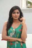 Actress Eesha Latest Pos in Green Floral Jumpsuit at Darshakudu Movie Teaser Launch .COM 0053.JPG