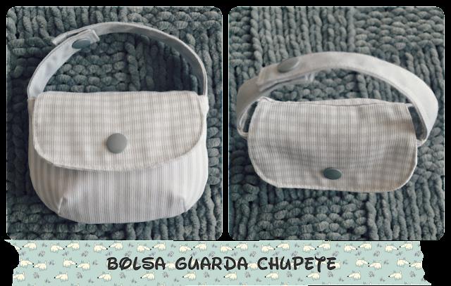 Bolsa guarda chupetes realizada en algodón en tonos grises claros y snap gris de plástico