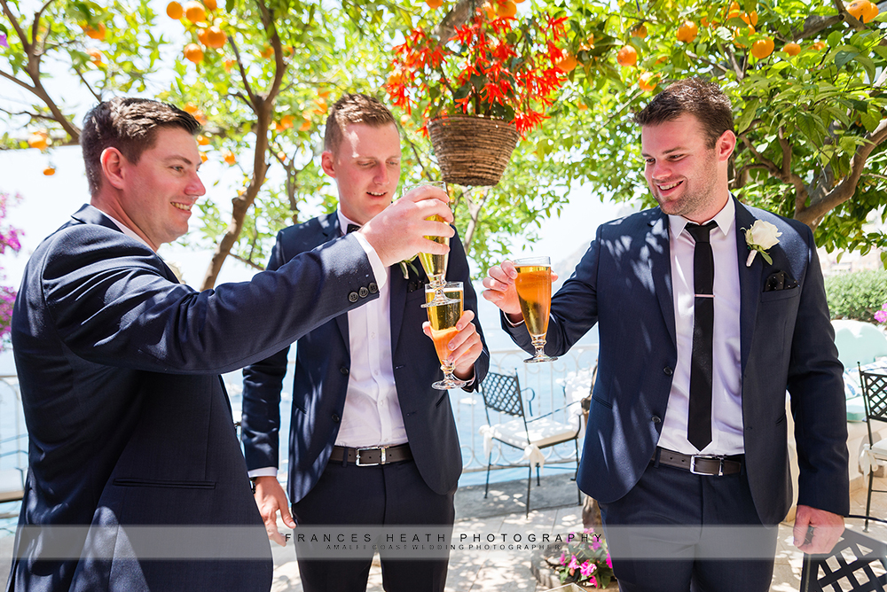 Groomsmen toasting groom with beer