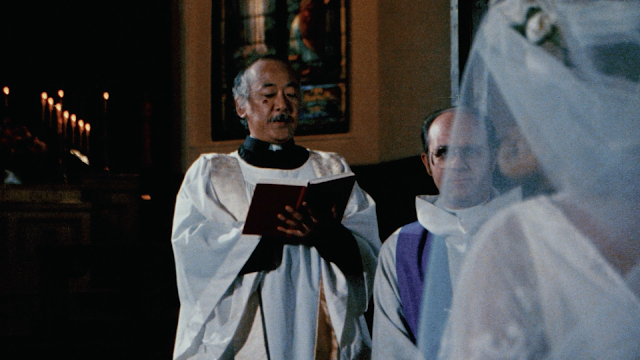 mr miyagi reads to bible while dressed as a priest because that is what he does on fridays