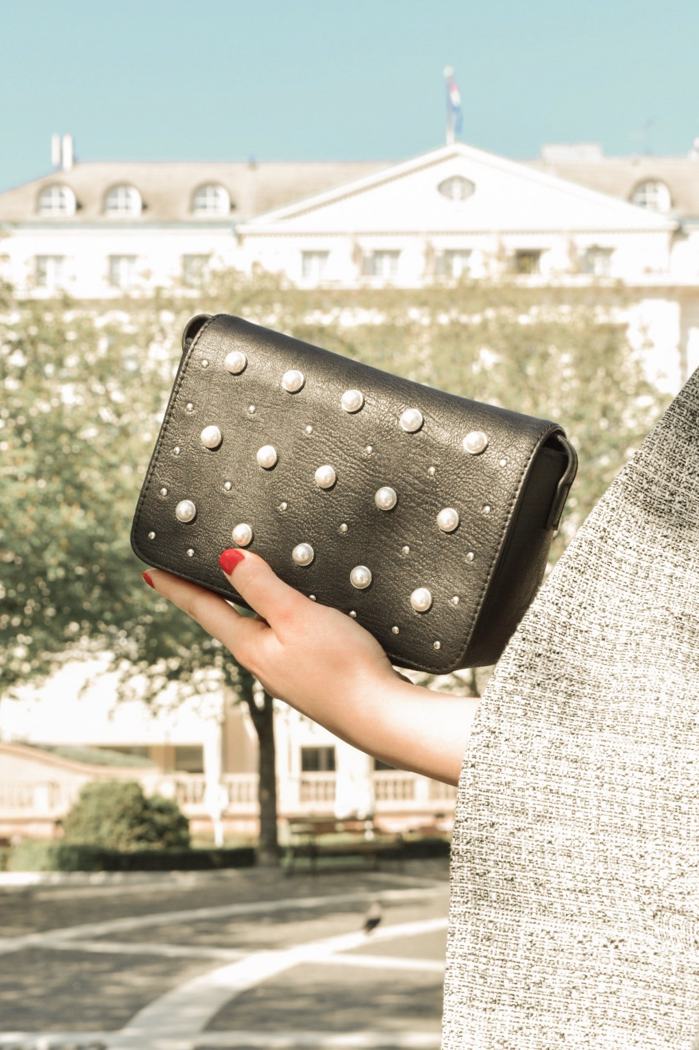 Black bag by H&M with pearls