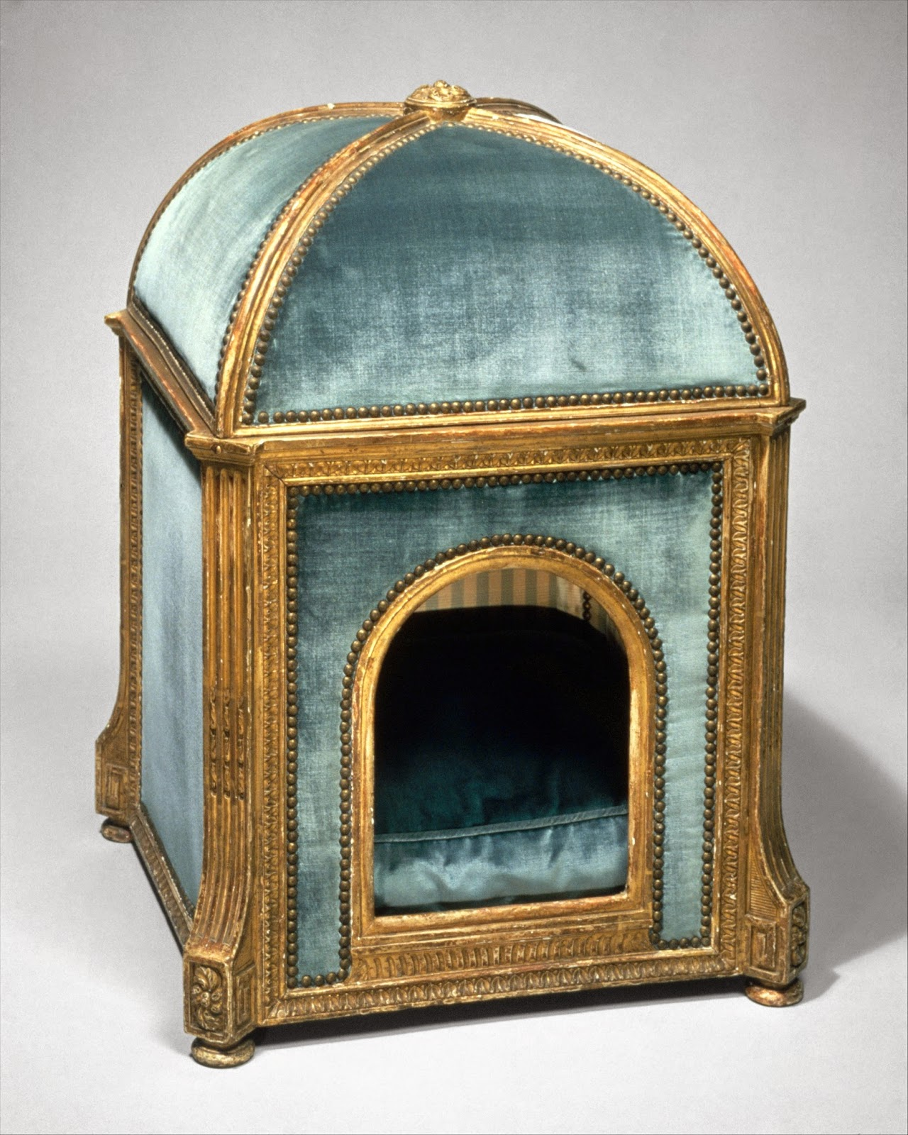 a blue velvet dog house has gold trim from the 18th century