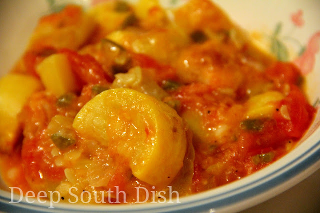 Fresh squash and tomatoes are paired with Vidalia onion and sweet bell peppers, topped with cheese and buttered bread crumbs and baked.