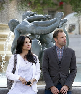 Jonny Lee Miller and Lucy Liu as Sherlock Holmes and Joan Watson in CBS Elementary Season 2 Episode 1 Step Nine