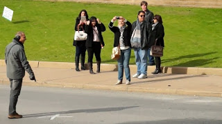 tourists at Dealey Plaza in Dallas Texas