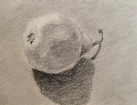 Graphite drawing of a pear by Manju Panchal in small sketch book