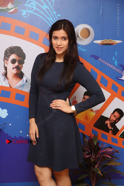 Actress Mannara Chopra Stills in Blue Short Dress at Rogue Song Launch at Radio City 91.1 FM  0044.jpg