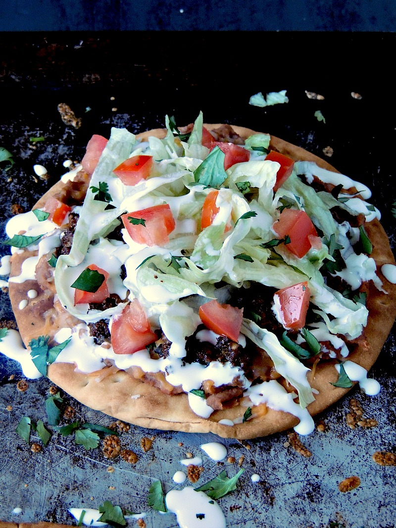 Mini Taco Pizza closeup on a metal baking sheet.