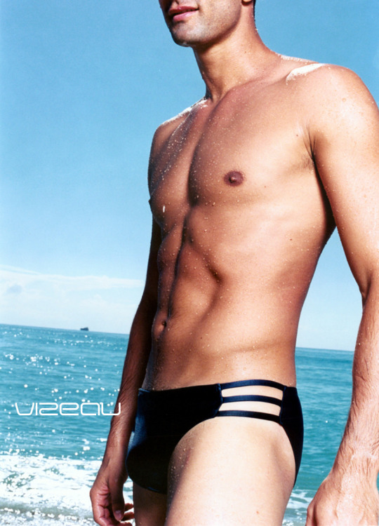 Fabrizio Brienza wearing swim brief 0183 by Vizeau with openings on both sides and straps