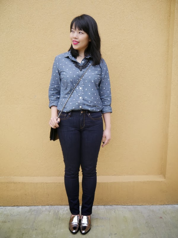 Fuchsia lips, black statement necklace, polka dot chambray shirt, Chanel WOC worn as a crossbody bag, and silver shoes