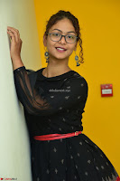 Aditi Myakal in Spicy Red Short Skirt and Transparent Black Top at at Big FM For Promotion of Movie Ami Tumi 028.JPG