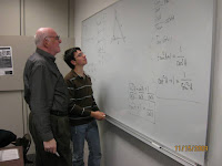 Boy with his grandfather at the whiteboard