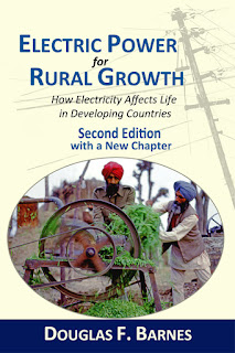 Book cover with 2 men from India using electric equipment to chop fodder.