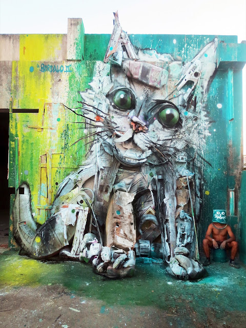 "After ""Trash Puppy"" a few days ago, Bordalo II just sent us some images from his latest street installation which is entitled ""Trash Cat""."