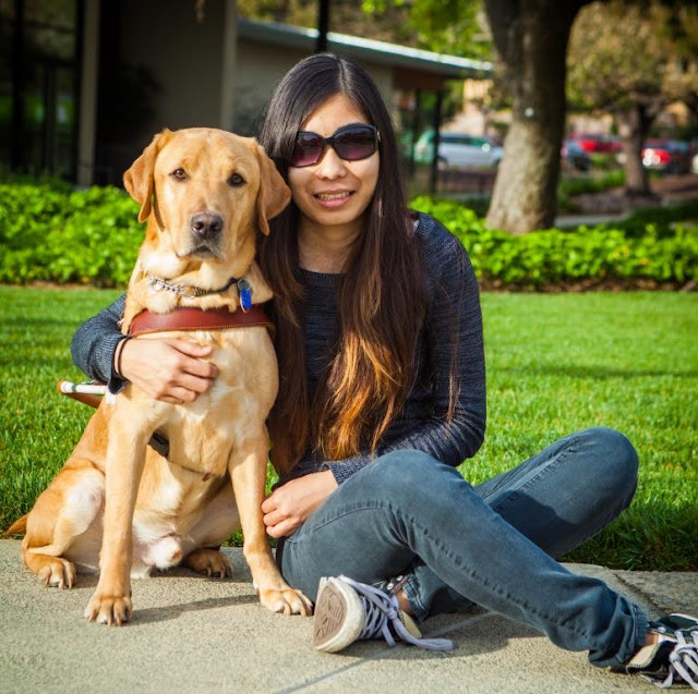 Oscar the guide dog and Michelle Yoo blind handler