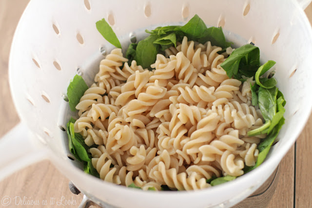 Drain pasta over spinach to quickly wilt
