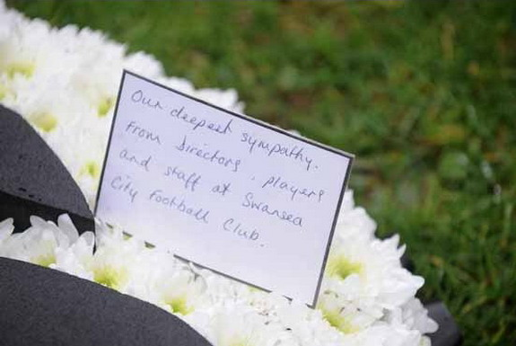 Swansea City send a specially-made club wreath to Scott Bryant's funeral